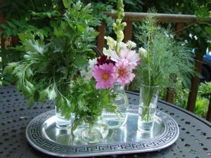 Parsley, Cilantro, and Dill surround some fresh cut flowers.